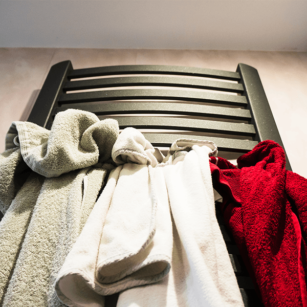 Drying clothes on a heater